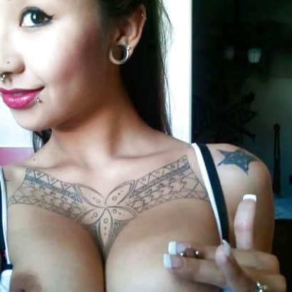 Dark haired pierced boobs