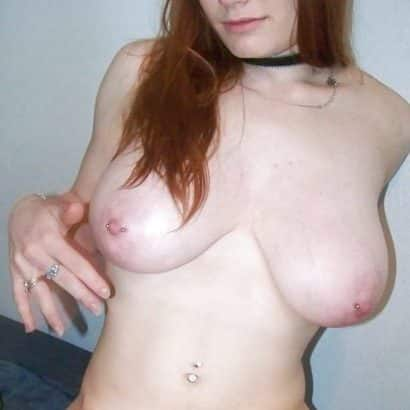 redhead with pierced boobs