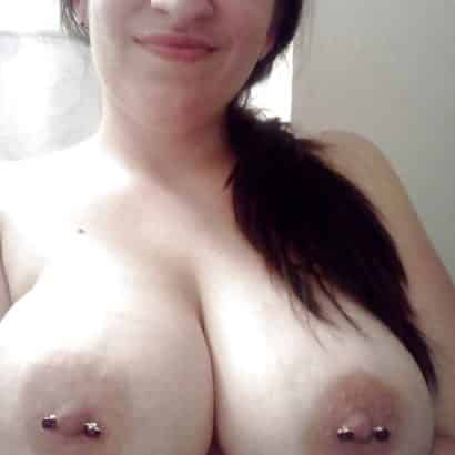 showing off her pierced boobs