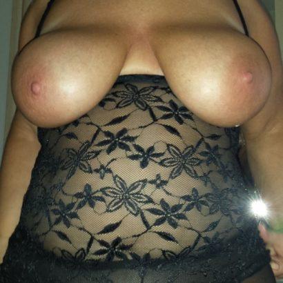 Flashing her big saggy tits