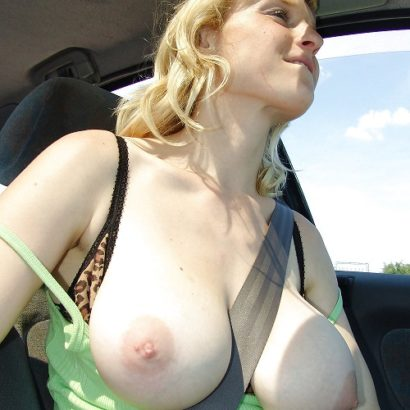 Boob reveal in her car