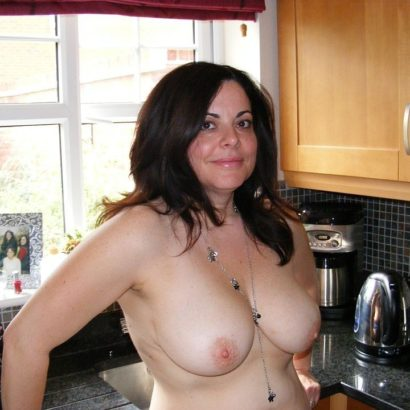 girls boobs in her kitchen