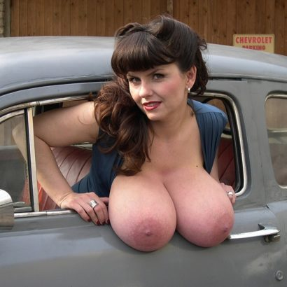 hanging her tits out of the car