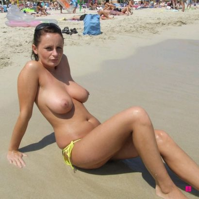 Busty babes in the sand